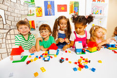 Many kids play with plastic blocks in classroom Royalty Free Stock Photo
