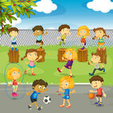 Many kids playing in the park Royalty Free Stock Image