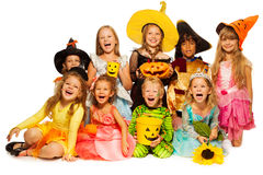 Many kids sit in group wearing Halloween costumes Stock Image