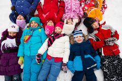 Many kids in snow Stock Photo