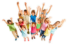 Many kids stand isolated on white in large group Stock Images