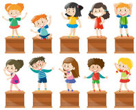 Many kids stand and sit on box Stock Photo