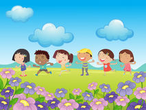 Many kids walking in the park Stock Images
