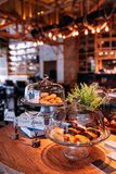 Many kind of Financier in glass tray covered by glass lid with out of focus restaurant in the background.  stock photo