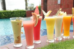 Many kind of juices. On at pool Royalty Free Stock Photos