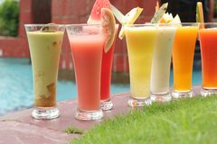 Many kind of juices. On at pool royalty free stock photography