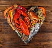 Many kind of seafood in heart shape. Served on crushed ice stock image
