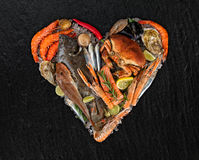 Many kind of seafood in heart shape. Served on crushed ice stock photography
