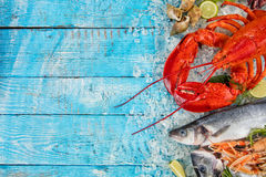 Many kind of seafood, served on crushed ice. Whole lobster with seafood, crab, mussels, prawns, fish, salmon steak, mackerel and other shells served on crushed Stock Photos