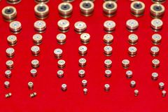 Many kind and size of o-ring straight plug screw for industrial put in a row on red background royalty free stock photos