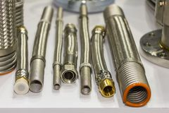 Many kind of stainless steel flexible hose and flange  for high and medium temperature or pressure system for industrial on table stock images