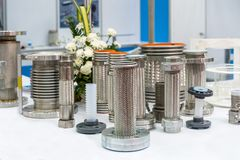 Many kind of stainless steel flexible hose and flange  for high and medium temperature or pressure system for industrial on table royalty free stock photo