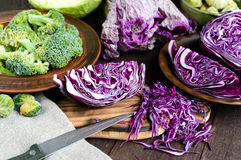 Many kinds of cabbage - red, broccoli, Brussels sprouts, white, napa cabbage. Stock Photos