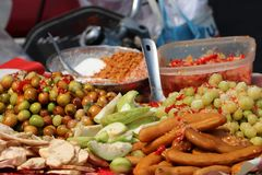 Many kinds of Cambodia pickled fruit such as Guava, tamarind, star gooseberry, jujube stock images