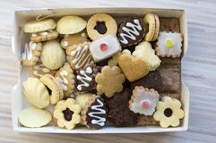 Many kinds of Christmas cookies in one pile in the box royalty free stock images