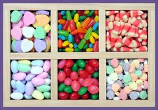 Many kinds of flavor candies in wooden box Royalty Free Stock Image