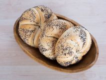 Bread rolls in the bowl. Many kinds of fresh pastries in a bowl Royalty Free Stock Photo