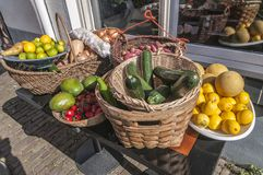 Many kinds of fruit outside on the street royalty free stock photos
