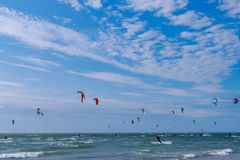 Kite surfers on the sea. Many kite surfers on the sea Royalty Free Stock Images