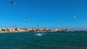 Many kite surfers in a sunny day in Spain, in Costa Brava, near the town Palamos. March 10. 2018, Spain stock footage