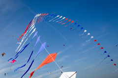 Many kites flying. In the blue sky Royalty Free Stock Photos