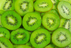 Many kiwi fruit slices background Stock Image