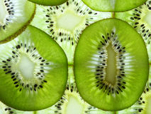 Many kiwi slices Stock Images
