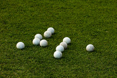 Many lacrosse balls on green grass royalty free stock photo