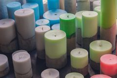Many large candles in pastel colors. Sale stock photo