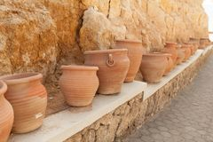 Many large clay pots standing in a row. Outdoor Royalty Free Stock Image