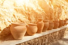 Many large clay pots standing in a row. Outdoor Stock Image
