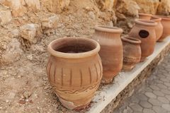 Many large clay pots standing in a row. Outdoor Royalty Free Stock Photography