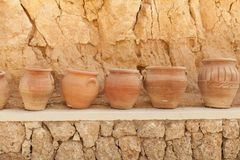 Many large clay pots standing in a row. Outdoor Stock Photography