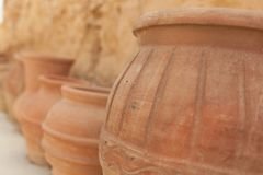 Many large clay pots standing in a row. Outdoor Royalty Free Stock Images