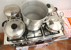 Many large pots with steel lid on the stove of the industrial ki Stock Photo