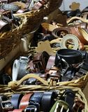 So many leather belts for sale in the clothing store. Leather belts for sale in the clothing store Royalty Free Stock Photography