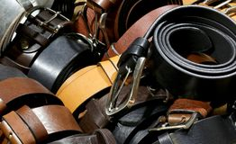 Many leather belts for sale. In the artisan workshop Royalty Free Stock Photos