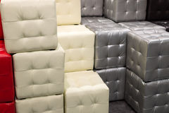 Many leather footstools of different colors in  stack Royalty Free Stock Photo
