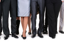 Many legs of a businesspeople. Sanding together royalty free stock images