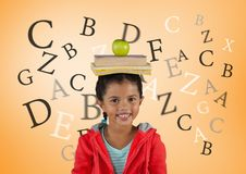 Many letters around Girl with books and apple on head in front of orange background Royalty Free Stock Images