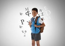 Many letters around Schoolboy in front of grey background. Digital composite of Many letters around Schoolboy in front of grey background Stock Photos