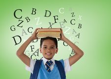 Many letters around Schoolboy holding books in front of green background Stock Image