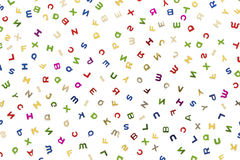 Many letters of various colors. Mixed Royalty Free Stock Photos