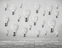 Many light bulb on wall. Mean more ideals Stock Photos