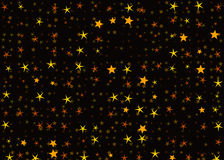 Many light yellow flying stars on black backgrounds Royalty Free Stock Photography