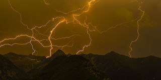 Many lightnings in the mountains stock images