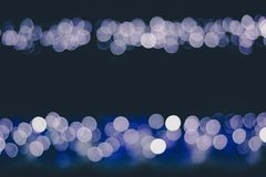 Many lights blurred bokeh in the dark. Many blue lights blurred bokeh background in the night royalty free stock photos