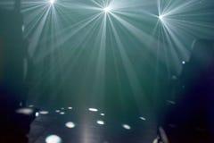 Many lights illuminating an empty stage. Many flood lights illuminating an empty stage royalty free stock photography