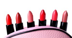 Many lipsticks in cosmetic bag Stock Photos