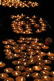 Many lit candles in the Church Stock Photography